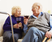 old couples drinking wine